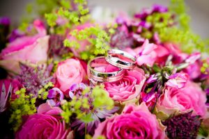 wedding rings in a bed of flowers
